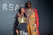 Kesha Ward and 2 Chainz attend the the Versace fall 2019 fashion show at the American Stock Exchange Building in lower Manhattan on December 02, 2018 in New York City.