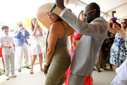 Co-host Donna Karan and Wyclef Jean dance at the Veuve Clicquot Polo Classic at Governor's Island on June 5, 2011 in New York City.