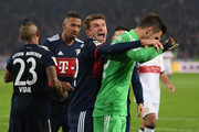 Sven Ulreich of Bayern Muenchen is congratulated by Thomas Mueller of Bayern Muenchen after he saved a penalty against Chadrac Akolo of Stuttgart (back) during the Bundesliga match between VfB Stuttgart and FC Bayern Muenchen at Mercedes-Benz Arena on December 16, 2017 in Stuttgart, Germany.
