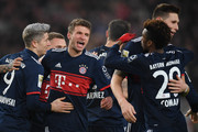 Thomas Mueller of Bayern Muenchen (c) celebrates with his team mates after he scored a goal to make it 0:1 during the Bundesliga match between VfB Stuttgart and FC Bayern Muenchen at Mercedes-Benz Arena on December 16, 2017 in Stuttgart, Germany.