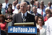 """U.S. Vice President Joseph Biden speaks as House Minority Leader Rep. Nancy Pelosi (D-CA) and other Senate and House Democrats listen during a press event on the House East Front Steps of the Capitol September 8, 2016 in Washington, DC. Congressional Democrats urge the Republicans to """"do your job!"""""""