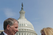 U.S. House of Representatives Victims' Rights Caucus Chairman Rep. Ted Poe (R-TX) (L) and Rep. Carolyn Maloney (D-NY) (R) talk with human trafficking survivor Shandra Woworuntu after a news conference outside the U.S. Capitol May 20, 2014 in Washington, DC. A native of Indonesia, Woworuntu graduated from college and worked at the Korea Exchange Bank before becoming a victim of human trafficking and sold into sexual slavery in New York City. The bipartisan lawmakers urged their colleagues to vote for The Justice for Victims of Trafficking Act and The Human Trafficking Fraud Enforcement Act of 2014.