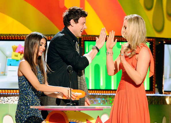 Victoria Justice Actor/singer Cory Monteith slaps the hand of Olympic gold medalist Lindsey Vonn as actress/singer Victoria Justice looks on onstage during Nickelodeon's 24th Annual Kids' Choice Awards at Galen Center on April 2, 2011 in Los Angeles, California.