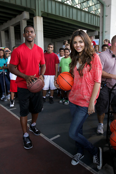 Victoria Justice NBA player Chris Paul teaches Nickelodeon's Victoria Justice to play basketball during Nickelodeon's Annual Worldwide Day of Play at NYC Big Brothers Big Sisters RBC Race for the Kids Event in Riverside Park on September 25, 2010 in New York City.
