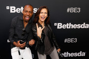 (L-R) Gaming editor Malik Forte and host of Nerdist News Jessica Chobot pose for a photograph as they arrives to the Bethesda E3 2015 press conference at the Dolby Theatre on June 14, 2015 in Los Angeles, California. The Bethesda press conference is held in conjunction with the annual Electronic Entertainment Expo (E3) which focuses on gaming systems and interactive entertainment, featuring introductions to new products and technologies.