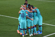 Antoine Griezmann of Barcelona celebrates after scoring his sides third goal with team mates during the Liga match between Villarreal CF and FC Barcelona at Estadio de la Ceramica on July 05, 2020 in Villareal, Spain.