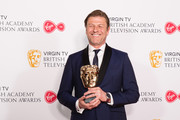 Winner of the Leading Actor award for 'Broken', Sean Bean poses in the press room at the Virgin TV British Academy Television Awards at The Royal Festival Hall on May 13, 2018 in London, England.