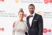 (L-R) Kate Wright and Rio Ferdinand attend the Virgin TV British Academy Television Awards at The Royal Festival Hall on May 13, 2018 in London, England.