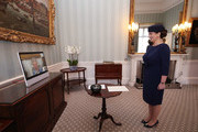 Queen Elizabeth II appears on a screen by videolink from Windsor Castle, where she is in residence, during a virtual audience to receive Her Excellency Ivita Burmistre, the Ambassador of Latvia, at Buckingham Palace on April 27, 2021 in London, England.