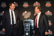 (L-R) Auburn Tigers Head Coach Gus Malzahn and Florida State Seminoles Head Coach Jimbo Fisher pose with the trophy during a Vizio BCS National Championship press conference at the Newport Beach Marriot Hotel and Spa on January 5, 2014 in Newport Beach, California.