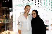 Model Karolina Kurkova and designer Reem Al-Kanhal at the International Design Showcase during the Vogue Fashion Dubai Experience on October 31, 2014 in Dubai, United Arab Emirates.