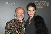 Farida Khelfa (R) and Christian Louboutin attends the Vogue Party as part of the Paris Fashion Week Womenswear Spring/Summer 2018 at Le Petit Palais on October 1, 2017 in Paris, France.
