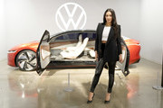 Shay Mitchell poses with the Volkswagen ID. VIZZION concept vehicle inside the 'Building an Electric Future' exhibit during the fourth annual Volkswagen Drive-In Movie at the Petersen Automotive Museum on November 21, 2019 in Los Angeles, California.