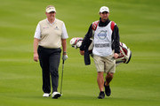 Colin Montgomerie of Scotland walks with his caddie Jason Hempelman during the Pro Am prior to the start of the Volvo Golf Champions at The Royal Golf Club on January 26, 2011 in Bahrain, Bahrain.