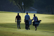 Lee Westwood and Ross Fisher of England walk to a green during Day Two of the Group Stage of the Volvo World Match Play Championship at Finca Cortesin on October 30, 2009 in Casares, Spain.