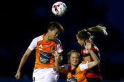 Wai Ki Cheung and Abbey Lloyd of the Roar compete for the ball with Maruschka Waldus of the Wanderers. during the round three W-League match between the Western Sydney Wanderers and the Brisbane Roar at Marconi Stadium on November 10, 2017 in Sydney, Australia.