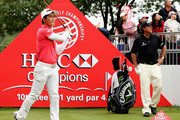 Liang Wen-chong of China hits his tee-shot on the tenth hole as Phil Mickelson of the USA looks on during the final round of the WGC - HSBC Champions at the Sheshan International Golf Club on November 3, 2013 in Shanghai, China.