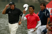 (L to R) Phil Mickelson of the USA, Liang Wen-chong of China and Jason Dufner of the USA wave to the crowd on the 18th hole during the final round of the WGC-HSBC Champions at the Sheshan International Golf Club on November 3, 2013 in Shanghai, China.
