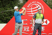Jordan Spieth (L) of the United States hits his tee shot on the 11th hole as Bubba Watson of the United States looks on during the first round of the WGC - HSBC Champions at the Sheshan International Golf Club on November 5, 2015 in Shanghai, China.