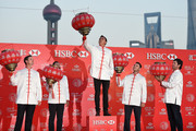 Rickie Fowler of the United States (C) hangs a Chinese lantern as Justin Rose of England, Adam Scott of Australia, Martin Kaymer of Germany and Bubba Watson of the United States look on, at the Peninsula Hotel prior to the start of the WGC - HSBC Champions on November 4, 2014 in Shanghai, China.