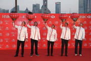 (L to R) Justin Rose of England, Bubba Watson and Rickie Fowler of the United States, Adam Scott of Australia and Martin Kaymer of Germany hang traditional Chinese lanterns atop the Peninsula Hotel prior to the start of the WGC - HSBC Champions on November 4, 2014 in Shanghai, China.