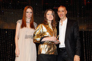 Model Coco Rocha (L) and Robert Verdi (R) pose with award winner for Most Influential Designer, Womenswear during the WGSN Global Fashion Awards at Gotham Hall on October 20, 2011 in New York City.