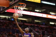 Western Conference All-Star Nneka Ogwumike #30 of the Los Angeles Sparks lays up a shot past Eastern Conference All-Star Chiney Ogwumike #13 of the Connecticut Sun during the first half of the WNBA All-Star Game at US Airways Center on July 19, 2014 in Phoenix, Arizona.
