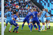 Jill Scott of Manchester City Women (obscured right) scores their first goal with a header during the WSL 1 match between Manchester City Women and Chelsea Ladies FC at Academy Stadium on September 25, 2016 in Manchester, England.