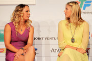 Caroline Wozniacki of Denmark and Maria Sharapova of Russia sit next to one another on the stage during the draw ceremony for the TEB BNP Paribas WTA Championships at the Sheraton on October 23, 2011 in Istanbul, Turkey.