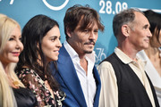 """(l-R) Monika Bacardi, Olga Segura, Johnny Depp and Mark Rylance attend """"Waiting For The Barbarians"""" photocall during the 76th Venice Film Festival on September 06, 2019 in Venice, Italy."""