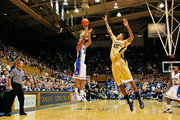 Andre Dawkins #20 of the Duke Blue Devils shoots a three-point basket over Ty Walker #40 of the Wake Forest Demon Deacons during play at Cameron Indoor Stadium on January 19, 2012 in Durham, North Carolina. Duke won 91-73.