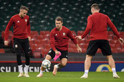 Chris Gunter looks on as Aaron Ramsey controls the ball during a Wales Training Session at Principality Stadium on October 10, 2018 in Cardiff, Wales.