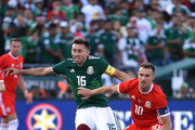 Hector Herrera #16 of Mexico gets a push from Aaron Ramsey #10 of Wales during the first half of their friendly international soccer match at the Rose Bowl on May 28, 2018 in Pasadena, California.