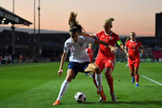 Jill Scott of England holds off Sophie Ingle of Wales during the Women's World Cup qualifier between Wales Women and England Women at Rodney Parade on August 31, 2018 in Newport, Wales.