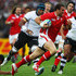 Jamie Roberts of Wales breaks with the ball during the IRB Rugby World Cup Pool D match between Wales and Fiji at Waikato Stadium on October 2, 2011 in Hamilton, New Zealand. - 4 of 12