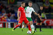 Aaron Ramsey of Wales is challenged by Jeff Hendrick of Ireland during the UEFA Nations League B group four match between Wales and Ireland at Cardiff City Stadium on September 6, 2018 in Cardiff, United Kingdom.