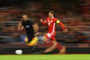 Aaron Ramsey of Wales in action during the International Friendly match between Wales and Spain on October 11, 2018 in Cardiff, United Kingdom.