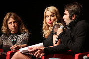 """Actress Valeria Marini (C) and director Christian Molina (R) speak on stage at the """"I Want To Be  A Soldier"""" press conference during the 5th International Rome Film Festival at Auditorium Parco Della Musica on November 2, 2010 in Rome, Italy."""