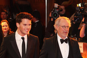 Director Steven Spielberg (R) and actor Jeremy Irvine attend the UK premiere of War Horse at Odeon Leicester Square on January 8, 2012 in London, England.