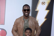"Sterling K. Brown and son, Andrew Brown attend the world premiere of ""Shazam!""  at TCL Chinese Theatre on March 28, 2019 in Hollywood, California."