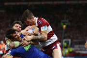 Stefan Ratchford of Warrington Wolves is tackled during the BetFred Super League Grand Final between Warrington Wolves v Wigan Warriors at Old Trafford on October 13, 2018 in Manchester, England.