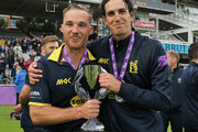 Laurie Evans (L) and Chris Wright (R) of Warwickshire celebrate winning the Royal London One-Day Cup Final after beating Surrey at Lord's Cricket Ground on September 17, 2016 in London, England. (Photo by Sarah Ansell/Getty Images).