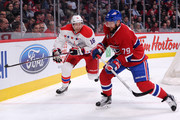 Eric Fehr #16 of the Washington Capitals and Andrei Markov #79 of the Montreal Canadiens battle for the puck in the corner during the NHL game at the Bell Centre on April 2, 2015 in Montreal, Quebec, Canada. The Capitals defeated the Canadiens 5-4 in overtime.