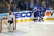 Ryan Callahan #24 of the Tampa Bay Lightning celebrates with his teammates after scoring a goal on Braden Holtby #70 of the Washington Capitals during the second period  in Game Five of the Eastern Conference Finals during the 2018 NHL Stanley Cup Playoffs at Amalie Arena on May 19, 2018 in Tampa, Florida.