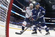 Evgeny Kuznetsov #92 of the Washington Capitals checks Ryan Callahan #24 of the Tampa Bay Lightning in Game Two of the Eastern Conference Finals during the 2018 NHL Stanley Cup Playoffs at the Amalie Arena on May 13, 2018 in Tampa, Florida. The Capitals defeated the Lightning 6-2.