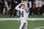 Andy Dalton #14 of the Dallas Cowboys reacts during the third quarter of a game against the Washington Football Team at AT&T Stadium on November 26, 2020 in Arlington, Texas.