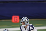 Andy Dalton #14 of the Dallas Cowboys looks on from the line of scrimmage during the first quarter of a game against the Washington Football Team at AT&T Stadium on November 26, 2020 in Arlington, Texas.
