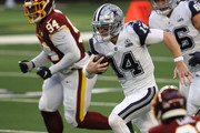 Andy Dalton #14 of the Dallas Cowboys rushes during the first quarter of a game against the Washington Football Team at AT&T Stadium on November 26, 2020 in Arlington, Texas.