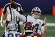 Andy Dalton #14 of the Dallas Cowboys throws a 54-yard pass for a touchdown during the second quarter of a game against the Washington Football Team at AT&T Stadium on November 26, 2020 in Arlington, Texas.