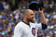 Starting pitcher Jon Lester #34 of the Chicago Cubs tips his hat to the crowd after being lifted in the 7th inning with two out against the Washington Nationals at Wrigley Field on August 6, 2017 in Chicago, Illinois.